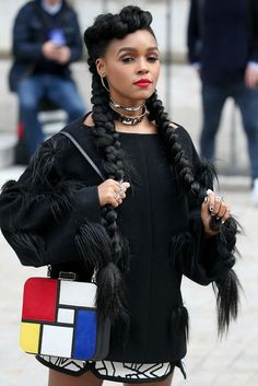 Janelle Monae owned Paris Fashion Week from the moment she showed up at Stella McCartney with these big, bad pigtails.