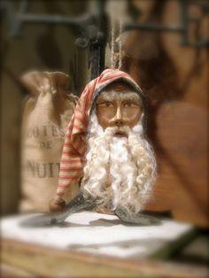 primitive santa .. did someone cut off santa's head and shrink it.. OH MY!!!