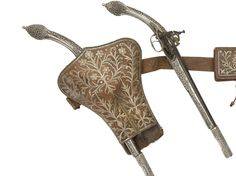 A pair of silver mounted miquelet holster pistols with original holster and ammo pouch, originates from the Balkans, 19th century