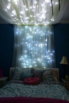 Add some string lights to create a whimsical effect for your bed canopy.