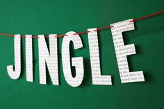 Christmas Banner - Garland - Jingle Bells - Vintage Book Paper. $10.00, via Etsy.