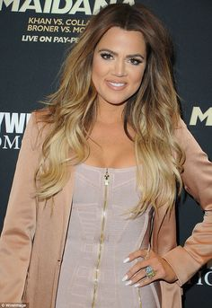 Gorgeous: Khloe was radiant in a clingy buff-coloured bandage dress and creamy blazer...