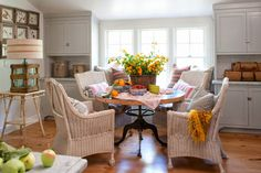 wicket chairs and round table with iron base