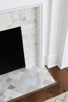 A White Marble Tile Fireplace Update | The DIY Playbook Fireplace Hearth Tiles, Fireplace Update, Old Fireplace, Marble Fireplaces, Fireplace Remodel, Fireplace Surrounds, Fireplace Design, Fireplace Ideas, Tile Around Fireplace