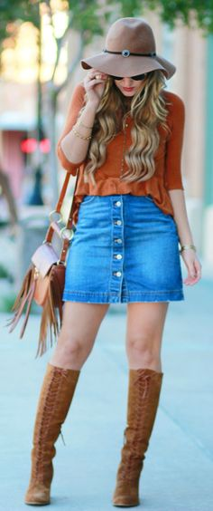 Boho fall outfit styled with lace up boots, rust top, button up skirt, and fringe crossbody bag