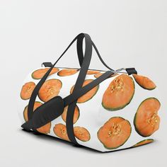 We upped the Duffle Bag game. Your new favorite gym and travel bags feature crisp printed designs on durable poly poplin canvas. Constructed with premium details for ultimate comfort. Available in three sizes.     - Durable poly poplin, canvas-like exterior   - Soft polyester lining with interior zip pocket   - Adjustable shoulder strap with foam pad and carrying handles   - Double zipper pull tabs for easy open/close   - Brushed nickel metal hardware