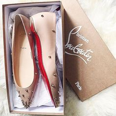 Fresh out of the box: new Christian Louboutin spiked flats. [photo weworewhat]