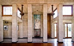 precast textured carved stone tile, verticality of fp wall via mosaic -mother of pearl natural color influence Frank Loyd Wright, Ennis House. Fireplace wall in living room with mosaic above firebox. Interesting Buildings, Amazing Buildings, Frank Loyd Wright Houses, Ennis House, Brown House, Historic Properties, Architectural Photographers, Room Interior Design, Fireplace Wall