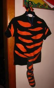LS orange shirt w/ SS black on top. Cut slits for the tiger stripes.