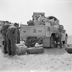 BRITISH ARMY NORTH AFRICA 1942 (E 12357)   An LRDG Chevrolet 30cwt truck is reloaded after a tyre change, 25 May 1942.