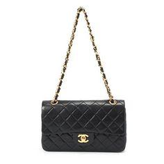 Sac à main matelassé Chanel en cuir noir