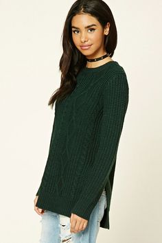 A sweater featuring a cable and ribbed knit designs, a longline silhouette…