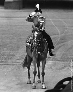 Queen Elizabeth II riding a horseside saddle and saluting during a Trooping of the Colour ceremony at Horse Guard's Parade, Central London. (Photo by William Vanderson/Fox Photos/Getty Images). 7th June 1952