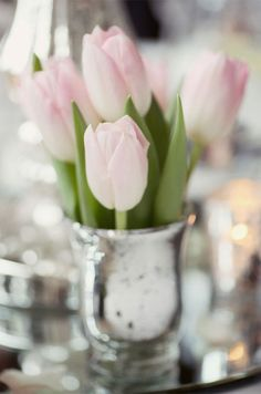 Just a few blooms make a huge impact in these silver mercury glass vases. Spring Wedding Decoration Ideas