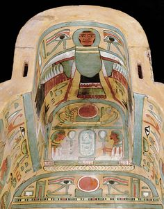 The inside-top part of the Merrin Gallery's sarcophagus features hieroglyphic inscriptions, seated jackal deities, as well as a Ba-bird, Anubis, and Ipt.
