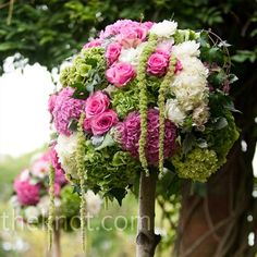 Hanging potted flowers petunias, etc from trees, etcoutdoor wedding ceremony pink flowers hydrangeas roses