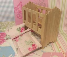 Craft stick or lolly stick cot with pillow, pillow case, mattress and duvet.