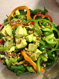 Easy, healthy salad with baby spinach, assorted peppers, avocado and walnuts. #eatclean #salad