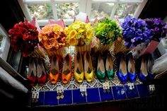 This is from a Wedding in a Week contest of some sort, beautiful pictures.  The attendants wore LBD's with rainbow shoes and bouquets, the groomsmen had matching flowers, socks and raybans.  Fun use of color for the bridal party.