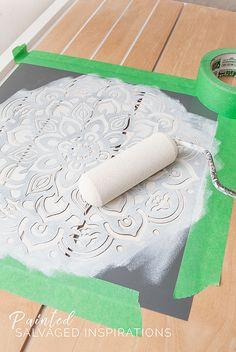 Rolling Paint onto Mandala Stencil For Dresser Makeover - Love this Mandala Stencil Design   How To Tutorial by Denise at Salvaged Inspirations