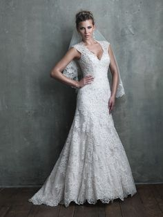 Contoured straps, a sheer back, embroidered with beading, and a modified A-line silhouette make this gown both flattering to your curves and undeniably gorgeous.  Allure bridal wedding dress