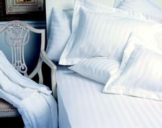 White bed linen with a satin stripe twist!
