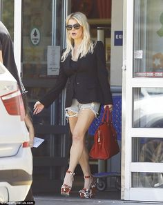 Legging it: Jessica Simpson showed off her shapely pins as she headed to a toy store in Lo...