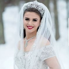 It may be COLD, COLD, COLD but our brides are HOT, HOT, HOT!!!, Crystal tiara by Bridal Styles Boutique.    #winterwedding #fairytale