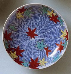 Dish with Design of Maple Leaves and Spider Web  Period: Edo period (1615–1868) Date: 18th century Culture: Japan Medium: Porcelain with underglaze blue and overglaze enamels (Hizen ware, Nabeshima type) Dimensions: Diam. 5 3/4 in. (14.6 cm) Classification: Ceramic