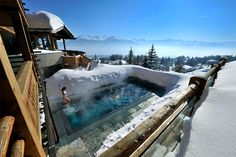 Lecrans hotel & spa with amazing hot pool during cold snowy days, Switzerland. Photo by: Lecrans Hotel & Spa
