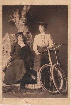 Two Victorian ladies with bicycles