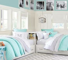 aqua and grey nursery, with a day bed for guests.