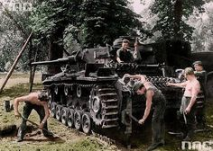 Crew members installing the tracks on their Panzer 3 Ausf H while operating with the 13th Panzer Division in France during the summer of 1941