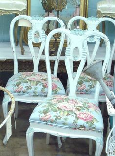 Chairs redone with blue shabby chic fabric with pink roses.