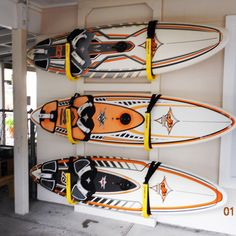 indoor and outdoor race, touring, surf paddleboard wall storage racks; great for decks, docks, garages