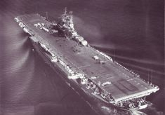 Original (1943) wooden straight deck configuration of Essex class USS Yorktown (CV-10). This photo was taken on 30 Sep 1944 during sea trials during WWII.