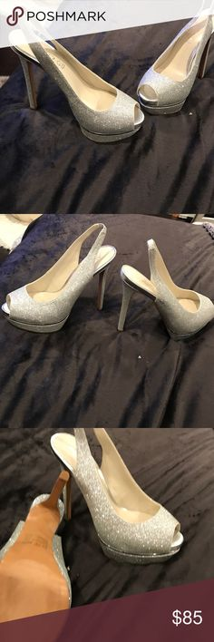 Aldo silver glitter platform shoes Bought these shoes for my wedding and never wore them , they are Gorgeous, definitely perfect for fancy occasions or just a statement heel yo dress up any outfit. They are peeptoe and approximately 3-4 inch heel with slight platform Aldo Shoes Heels