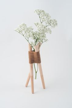 French designer Aurélie Richard created these vases from simple wood pieces woven together with yarn.