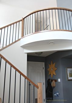 2 storey entryway, foyer and stairwell with wood and metal railing. Sherwin Williams Creamy and Benjamin Moore Steel Wool. Staircase Metal, Metal Railings, Foyer Design, E Design, Sherwin Williams Creamy, Best Paint Colors, Window Styles, Home Reno, Wood And Metal