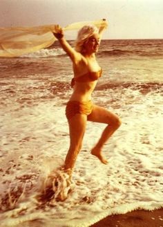 Marilyn photographed by George Barris on the Santa Monica Beach in July 1962.