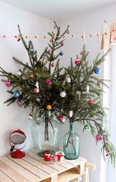 Thinking about having an alternative Christmas tree? Want to see the best ideas? We've rounded up the top 16 alternative Christmas tree ideas. Merry Little Christmas, Noel Christmas, Winter Christmas, Vintage Christmas, Christmas Crafts, Christmas Branches, Christmas Design, Green Christmas, Christmas Tree Branches