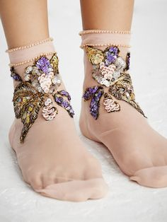 Time For Iris Sequin Sock | Made in France, these delicate sheer ankle socks feature stunning shimmering embroidery and sequin embellishments. Subtle beads along the opening. Contrast heel and toe.