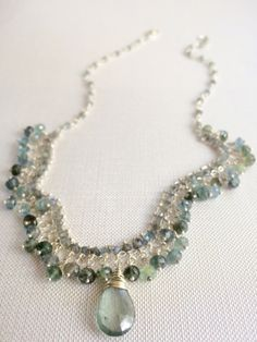 """Moss Aquamarine and Labradorite Necklace This one is a stunner of translucent sea greens and blues... very feminine and dainty. 16"""" of Sterling silver and small, faceted labradorite beads from which slightly larger faceted moss aquamarine rondelles hang below. A large, moss aqua briolette is the center focal point. Labradorite, Larger, Turquoise Necklace, Blues, Pearl Necklace, Aqua, Jewelry Design, Feminine, Pearls"""