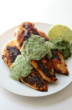 Coriander Garlic Grilled Chicken + Green Goddess Sauce | Strength and Sunshine @RebeccaGF666 The lemony tang of coriander with savory garlic, compliment the smoky taste of grilled chicken perfectly. Add a green goddess sauce full of herbs, tahini, coconut and lime to brighten this gluten-free and paleo healthy dinner entree even further, enticing the taste buds.