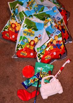 Wiggles Thank You Bags. Big Red car plaster with paint & paint brush, wiggles toothbrush, natural lollie chew & fredo frog with a balloon