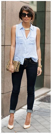 Sleeveless light blue chambray half tucked into dark indigo skinny jeans, blush heels and leopard clutch