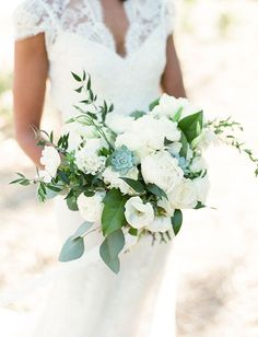 White peonies with lemon leaf & ruscus foliages.