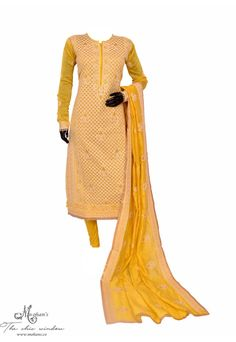 Delicate mustard suit in thread work