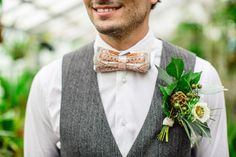 over-sized boutonniere, photo by Izzy Hudgins Photography http://ruffledblog.com/bohemian-wedding-inspiration-with-a-botanical-twist #groom #boutonnieres
