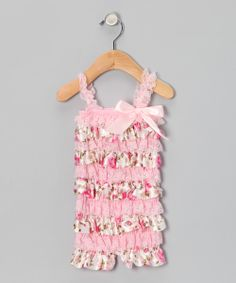 From deep inside the garden of cuteness bloomed this wonderful romper. Tiers of soft, stretchy ruffles and lacy straps deliver a dollop of style to this already adorable piece.